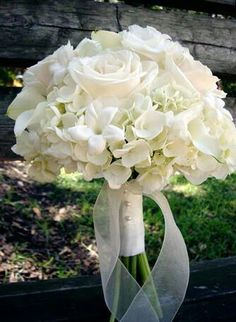 Traditional all white wedding bouquet with stephanotis, roses, and hydrangeas