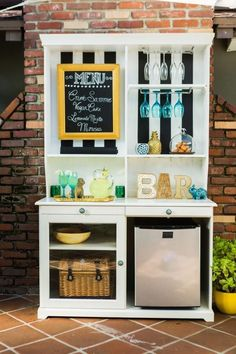 Upcycle a Hutch Into an Outdoor Bar and Buffet Have an old hutch or cabinet at home that's just collecting dust? HGTV shows you how to turn it into a beverage and food station (complete with mini fridge) for outdoor entertaining. Diy Außenbar, Easy Diy, Diy Outdoor Bar, Outdoor Living, Outdoor Buffet, Outdoor Ideas, Outdoor Decor, Outside Bars, Wine Glass Rack
