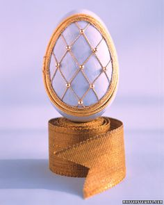 Latticed Eggs  For this trellis design, we glued imitation pearls on top of gold latticed thread.