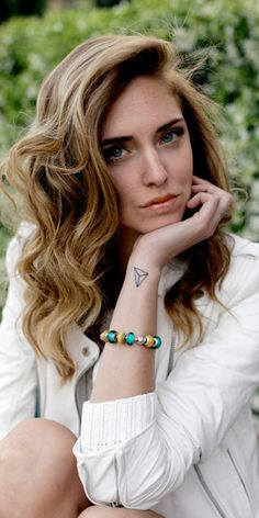 How blogger The Blonde Salad wears her Pandora bracelet with Summer whites. #myperfectPANDORAsummer @PANDORA