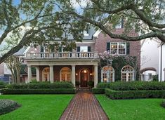 wide brick walkway up to the porch - barely a step up.  Significant columns.  Grounded with hedges as well.