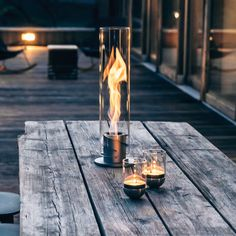 Brought to you by the same team behind the Cube Fire Pit, comes this fascinating whirl of flames in a decorative glass cylinder, bringing campfire atmosphere onto your balcony or terrace. The Spin Fire Tornado uses bioethanol fuel for a nearly smokel Outdoor Fire, Outdoor Living, Outdoor Decor, Bio Ethanol, Fire Tornado, Garden Torch, Portable Fireplace, Table Lanterns, Next Garden