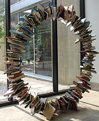 """The Plaza Branch of The Kansas City Public Library has a sculpture, titled """"Good As Gold,"""" created by internationally known artist, Donald Lipski."""