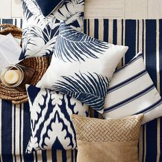 The fern pattern is a huge trend right now for decor and accessories. This Outdoor Printed Fern Pillow from Williams Sonoma is stylish and modern.