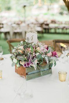 Rustic ranch wedding centerpiece: http://www.stylemepretty.com/2015/11/27/al-fresco-saddlerock-ranch-wedding/ | Photography: Koman Photography - http://komanphotography.com/: