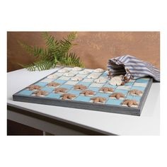 Seaside Checkers Game Board. Painted wooden checker board in cool beach colors of pale seawater blue and white will delight your beach house guests.