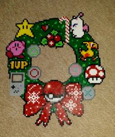 I saw a beautiful perler christmas wreath on pinterest and that's my version. Nintendo for me, playstation for my boyfriend! :)