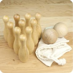 Roll the ball to knock down all ten pins for a strike - it's more challenging than it looks! Indoors and outdoors, wooden skittles bowling is a fun game of skill. The Classic Wood Skittles Game includes ten tall wooden pins and two dia