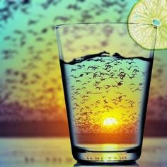 Spectacular sunset viewed through a drinking glass.