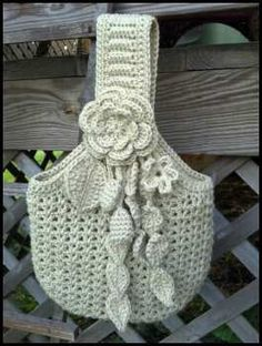 off white crocheted purse with crocheted flower