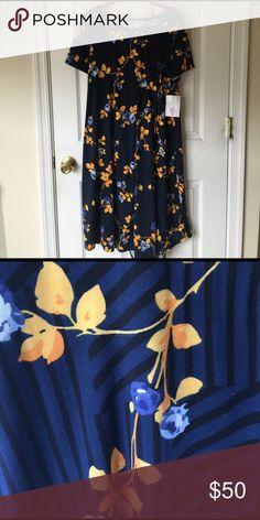 Medium Black, Blue, and Gold Carly Lularoe Medium Black, Blue, and Gold Carly; size Medium; NWT LuLaRoe Dresses