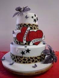 Wedding cake with leopard, stars, and hearts.