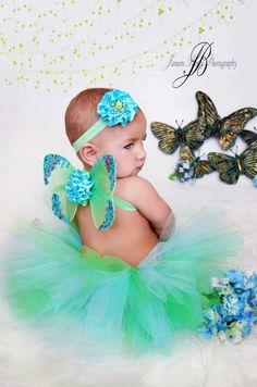 baby girls tutu headband and butterfly wings set with optional straps for older babies in blues and greens. $35.00, via Etsy.