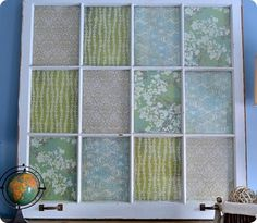 Old window + scrapbook paper.