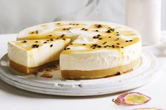 A syrupy passionfruit sauce take this lush white cheesecake to the next level.
