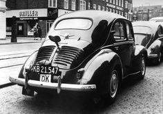 The back view of a Renault 4 CV car, parked in the centre of Copenhagen with a large key fitted to the boot giving passers-by the impression of a life-size clockwork car. (Photo by Keystone/Getty Images). Circa 1964