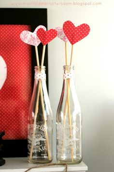 Keep the touches simple like these heart sticks in old ginger ale glasses for Valentine's Day. Valentine Home Decor Ideas on Frugal Coupon Living.