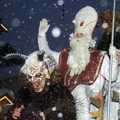Saint Nicholas and his companion Krampus participate in a parade on Nov. 24, 200 in St. Johann in the Austrian province of Tyrol. (AP Photo/Kerstin Joensson, file)