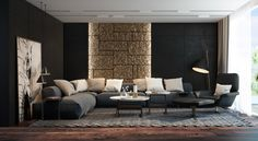 Black walls and a stone accent give this living room the feeling of a particularly stylish dungeon.