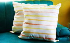 Use fabric dye sticks to DIY these pillows.