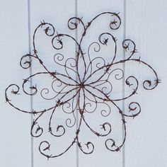 Barbed Wire Swirl; Wrought Iron Swirl; Barbed Wire Wall Decor; Rustic Decor; Front Door; Wall Hanging; Farmhouse Decor; Western Decor by BarbedWireandBurlap on Etsy https://www.etsy.com/listing/506414526/barbed-wire-swirl-wrought-iron-swirl