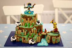 skylander cake idea. Portal of power on top, then grass/stick layer with sheep. Plus plastic figures