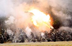 Troops fire 105mm howitzers during the celebration of the 118th Founding Anniversary of the Philippine Army at the military headquarters in Fort Bonifacio, Taguig City, Metro Manila, Philippines March 23, 2015. REUTERS/Romeo Ranoco