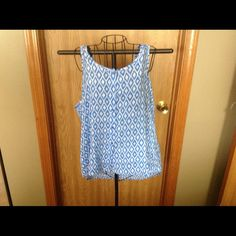 "Woman  Plus Blue and White Sleeveless top👚REDUCED Short  Long Top. It is button down but can put on without  unbuttoning. White with Blue diamond  print. Very comfy .wore once.  100% Rayon. Does not wrinkle. Machine washable.Front neckline to bottom is 19"". Back neckline to bottom is 27"". Bust measure at armhole all the way around 42"" Tops"