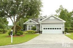 Incredible Property located in a cul de sac with views of the  Masonboro Country Club signature 2nd hole.
