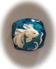 Handcarved Blue Goldfish Button.