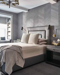 A rich array of textures adds depth and visual interest to a monochromatic bedroom.