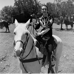 photo stories by LIFE photographers, Nina Leen, Peter Stackpole and Cornell Capa between 1947-48 at the University of Arizona Rodeo and the opening of the Flying L Ranch in Texas, vintage western wear, ornate embroidered rodeo outfit