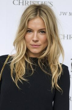 Natural blonde long loose waves suit Sienna Miller's face shape and tone
