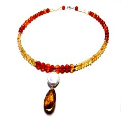 Add fiery style to your fashion arsenal with this cognac citrine pendant choker. Decorated with a warm blend of beaded citrine, carnelian, and coin pearls, this beautiful bohemian necklace secures with a toggle closure.