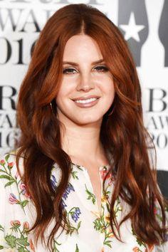 Lana Del Rey wears bright auburn with flashes of dark brown. GETTY