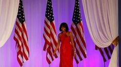 First lady Michelle Obama wore a ruby-colored, custom-made Jason Wu gown to the inauguration balls. She also wore a Wu creation four years ago.
