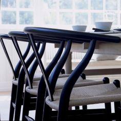 Buy the genuine, iconic Wishbone Chair by Hans Wegner for Carl Hansen & Son from Aram, London's best modern furniture store since