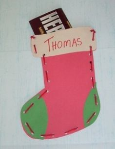 Punch holes and sew with yarn paper stocking - lacing card
