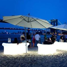Pretend you're at the #beach at NYC's Beekman Beer Garden Beach Club. With sand, glow-in-the-dark couches, and jaw-dropping views of New York's east side, you won't regret paying this spot at least one summer visit!  #FridayFunday #SouthStreetSeaport #SummerHotSpot #NYC
