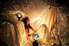 Blanket fort with a disco ball to make a starry effect. Awesome!