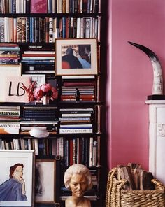Full bookshelves in a pink themed library