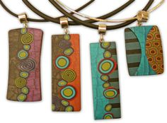 By the end of last week, you could spot Meisha Barbee& work on the neck of many Synergy shoppers. She combines simple canes and soothing colors in graphic ways with subtle textures woven in. The modern minimalist design continues through her f [. Polymer Clay Canes, Polymer Clay Necklace, Polymer Clay Pendant, Fimo Clay, Polymer Clay Projects, Polymer Clay Creations, Clay Design, Bijoux Diy, Metal Clay