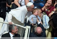CITE DU VATICAN: Pope Francis kisses a baby as he leaves at the end of a mass at St Peters square as part of the Palm Sunday celebration on March 24, 2013 at the Vatican. The Palm Sunday marks the start of the holy week of Easter in celebration of the crucifixion and resurrection of Jesus Christ. AFP PHOTO / GABRIEL BOUYS