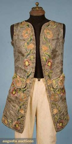 """Metallic silver brocade waistcoat, early 18th century;  All over metallic silver and blue bizzare pattern brocade, around perimeter and on pockets polychrome embroidered flowers and fruits in shades of pink, apricot, green and yellow, high-cut armholes, no collar, two linen lined pockets with flaps, 23 silver embroidered dome buttons at center front plus one button under each pocket flap, Ch 42"""", W 38"""", L 36"""""""