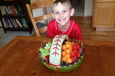 Watermellon baseball fruit basket for baseball party.Watermellon Fruit - i uses cantelope, honeydew (cut in squares), strawberries, pineapple (cut in triangles), blueberries Rope liccorice - just pull apart the strings White Chocolate - just a couple of squares of baking chocolate  Toothpicks