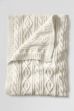 Lakeland Cotton Cable Throw from Lands' End- Bought it  & Love it. Half the price of Pottery Barn and all cotton!