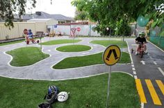bike tracks, preschools, childcare centres, schools, playgrounds, chiidrens biketracks, educational bike tracks, bike track construction, play bike tracks, school biketracks, I absolutely love the idea of having signs and directional markings on the playground! I have created some with chalk before, but this looks fabulous and brings attention to safety!