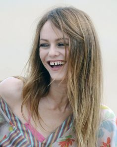 Beaming: Vanessa Paradis flashed her gap-tooth smile on the photo call for Je me suis fait tout petit in France yesterday
