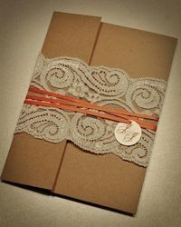 Amazing Brown paperbag folded wedding invites with lace and leather. So many cool ideas on here.