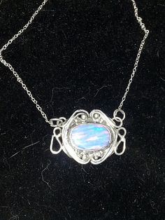 Lovely lab created Welo Opal necklace set in 925 SS. Char Gordon 2014